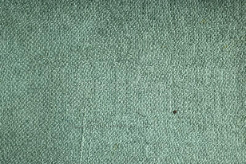 Primer de la textura verde de la materia textil para el fondo imágenes de archivo libres de regalías