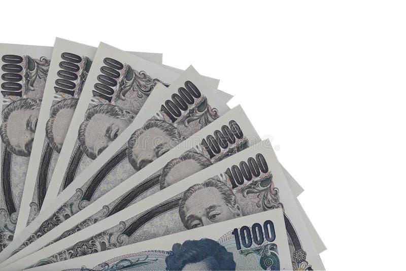 Primer de los billetes de banco japoneses de los yenes de la moneda fotografía de archivo libre de regalías