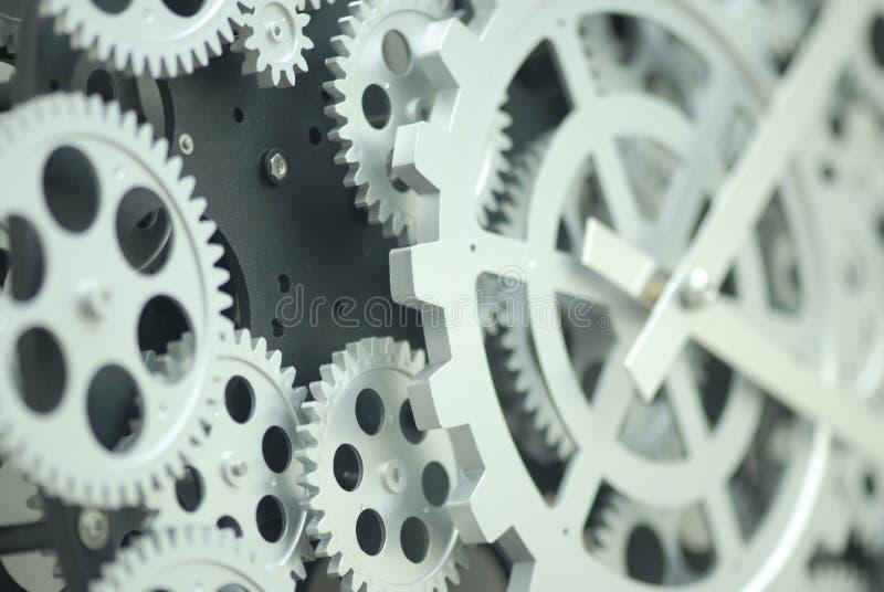 Primer de los engranajes internos del reloj imagen de archivo