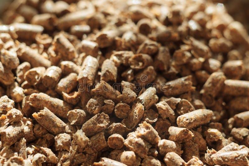 Primer de madera de la pelotilla de combustible Una fuente de energía limpia alternativa Mucha pelotilla Combustible y energía na fotos de archivo libres de regalías