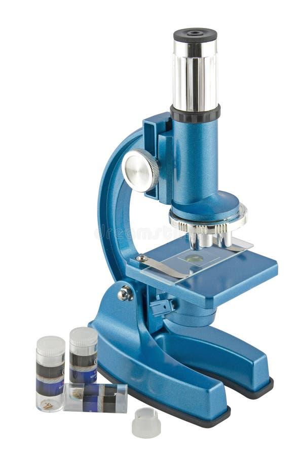 Primer de un microscopio azul imágenes de archivo libres de regalías