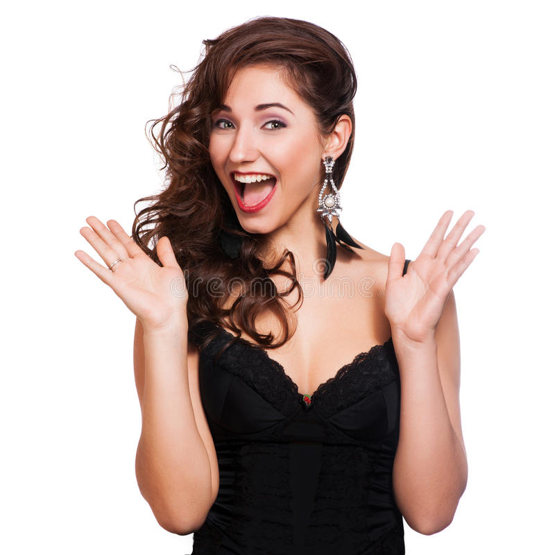 Primer de una mujer joven feliz sorprendida imagenes de archivo