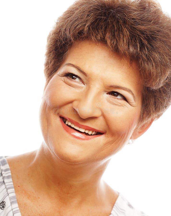 Primer de una sonrisa madura de la mujer fotos de archivo libres de regalías