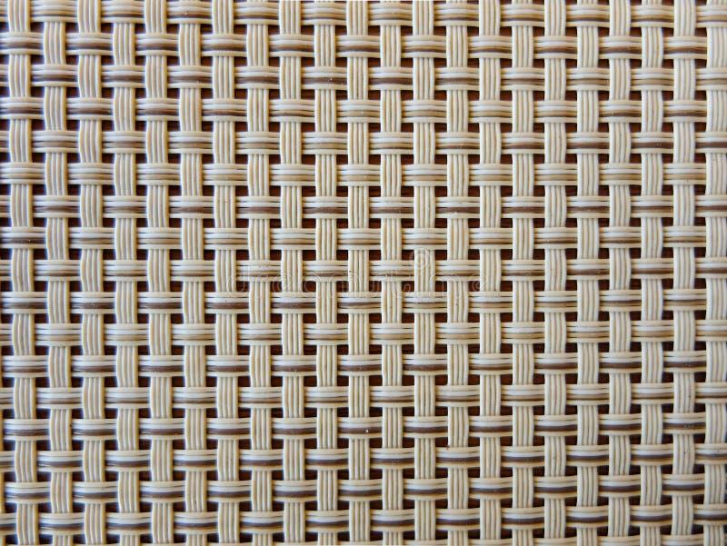 Primer del enrejado plástico de la tela beige, textura de la rejilla; modelo de líneas entretejidas horizontales y verticales fotografía de archivo