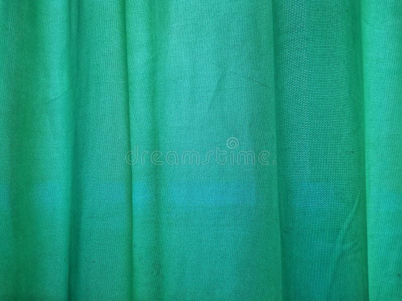 Primer del fondo verde de las cortinas fotografía de archivo libre de regalías