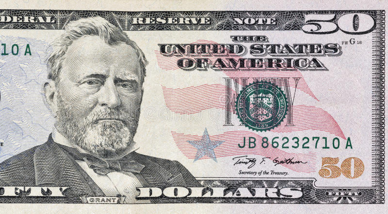 Primer del fragmento de cincuenta billetes de dólar foto de archivo
