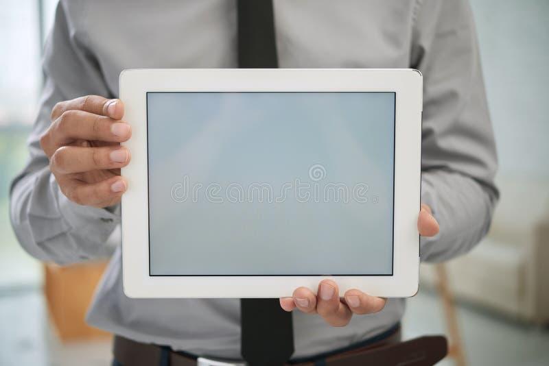 Primer del hombre de negocios con la tableta digital foto de archivo libre de regalías