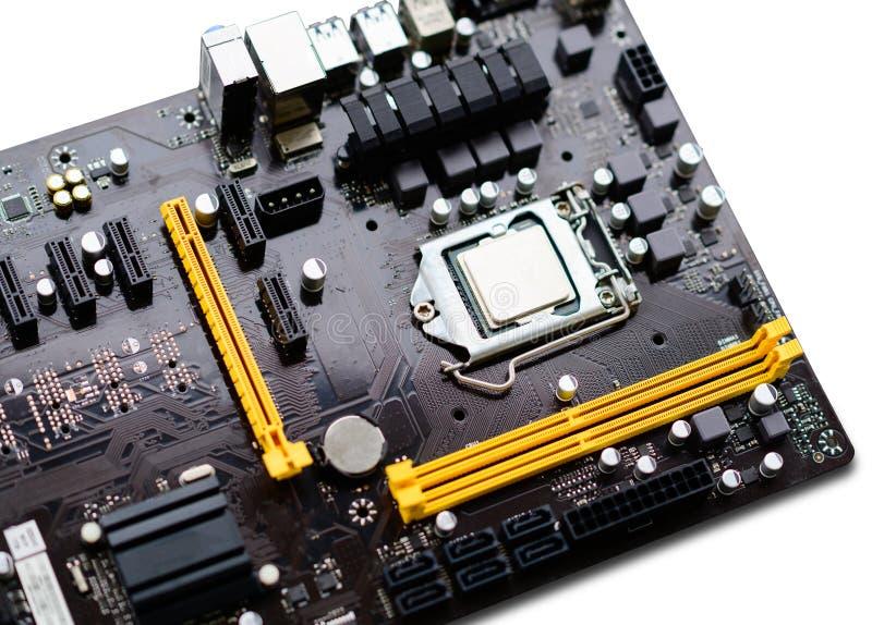 Primer del tablero de madre del ordenador con la CPU instalada foto de archivo