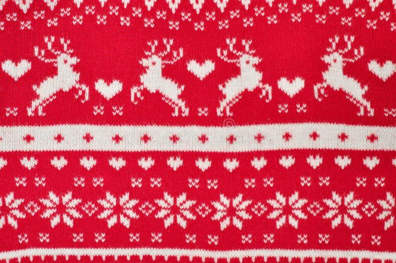 Primer hecho punto rojo del suéter de la Navidad de la decoración del elemento Regalo de vacaciones Backgdound imágenes de archivo libres de regalías