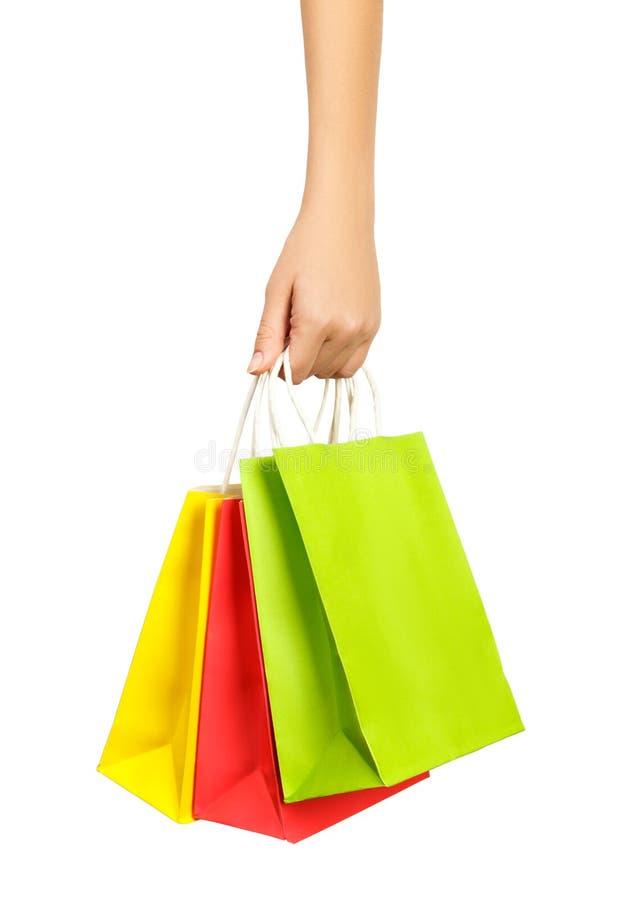 Primer o imagen de los bolsos de compras coloreados multi Aislado en el fondo blanco fotos de archivo libres de regalías