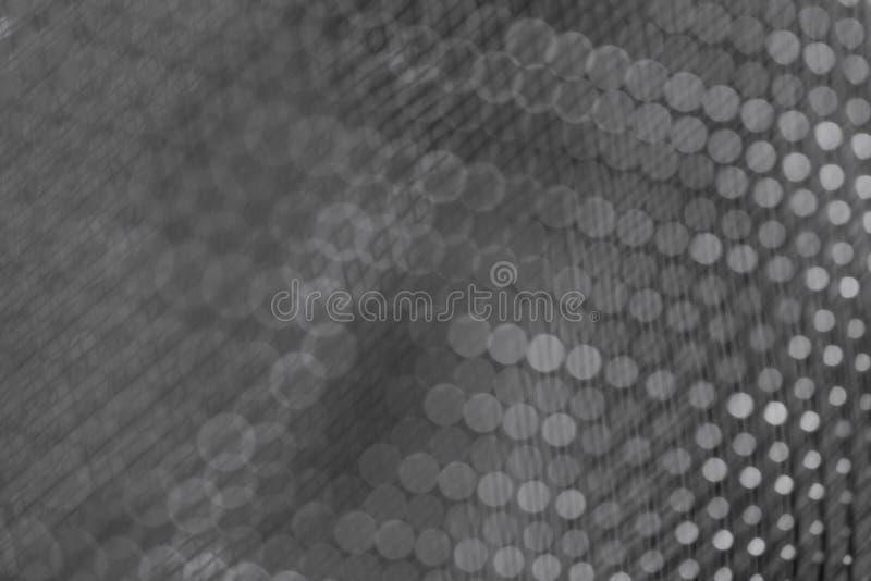 Primer oscuro del fondo de la malla metálica brillante fotos de archivo libres de regalías