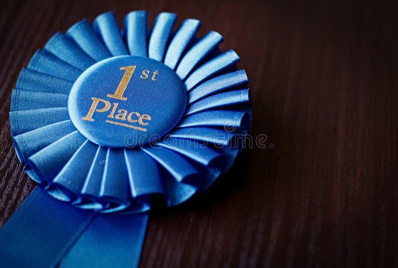Primer rosetón del ganador del lugar del azul imagenes de archivo