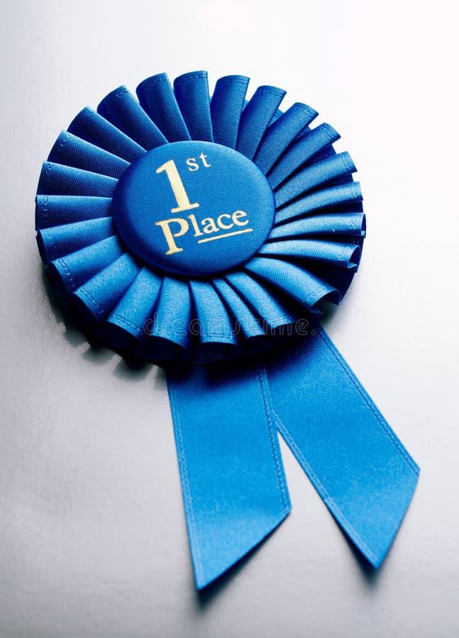 Primer rosetón del ganador del lugar del azul imagen de archivo