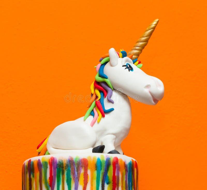 Primero de la torta del unicornio imagen de archivo libre de regalías