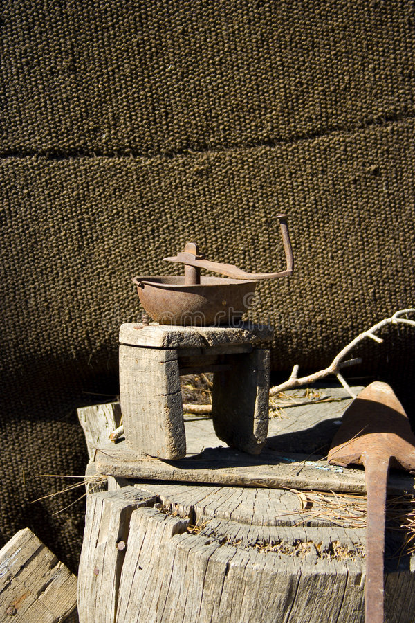 Primitive coffee grinder royalty free stock photos