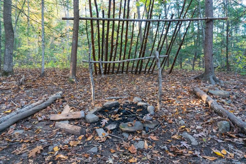 Primitive lean to Shelter with campfire  Survival Bushcraft setup in the Blue Ridge Mountains near Asheville. During stock photography