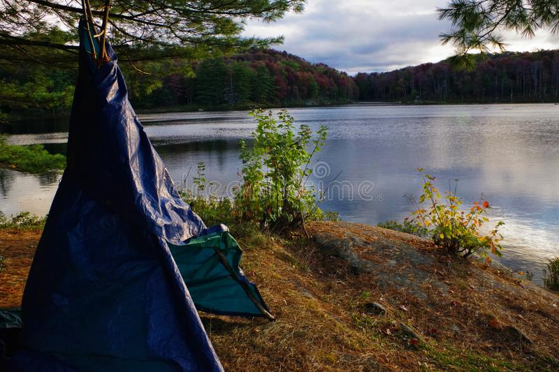 Primitive Tarp Teepee Shelter Campsite in the Adirondack Mountains During Near Peak Fall Leaf Foliage royalty free stock image