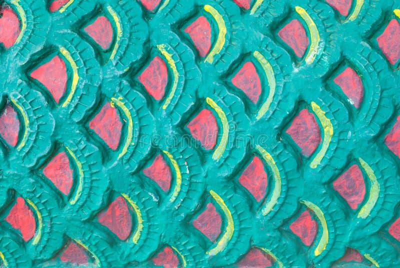 Primo piano alla pila di fondo rosso e verde del Naga del drago della scala fotografia stock libera da diritti