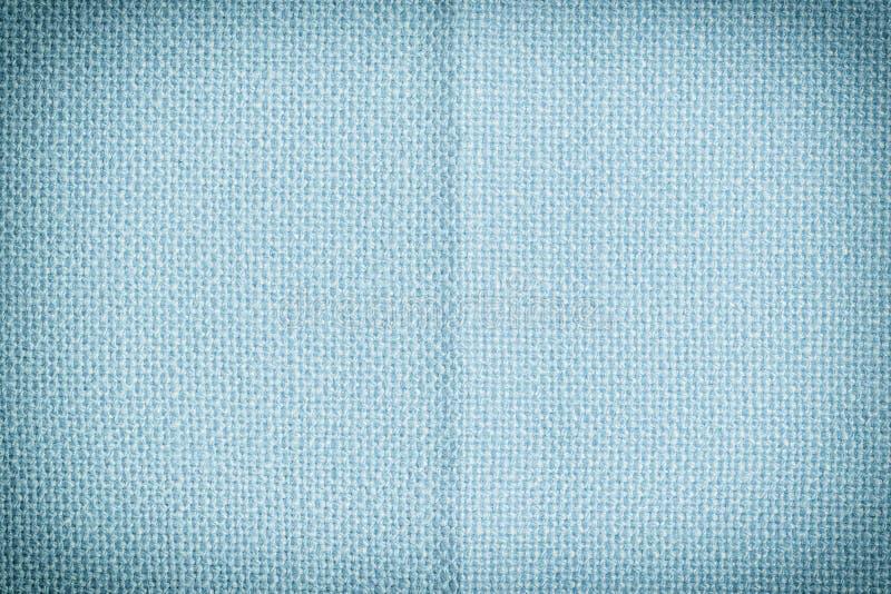Primo piano blu del tessuto Fondo in bianco per le disposizioni con struttura del tessuto fotografia stock libera da diritti