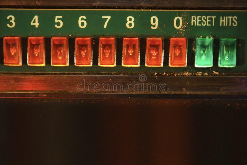Primo piano dei tasti del gioco del jukebox. fotografia stock