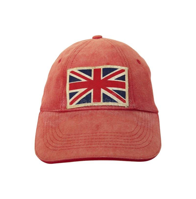 Primo piano del cappuccio stagionato grungy con la bandiera britannica su fondo bianco Concetto di Anglomania fotografie stock