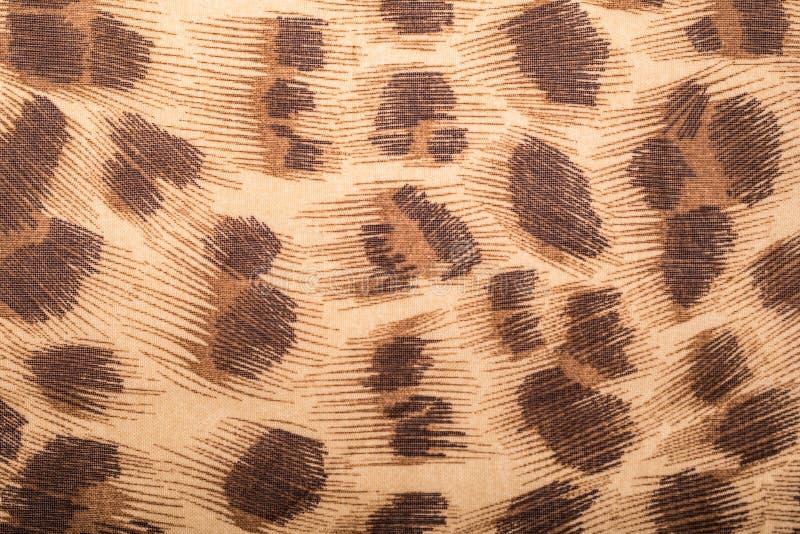 Primo piano del materiale indigeno di stile con progettazione della stampa del leopardo immagini stock
