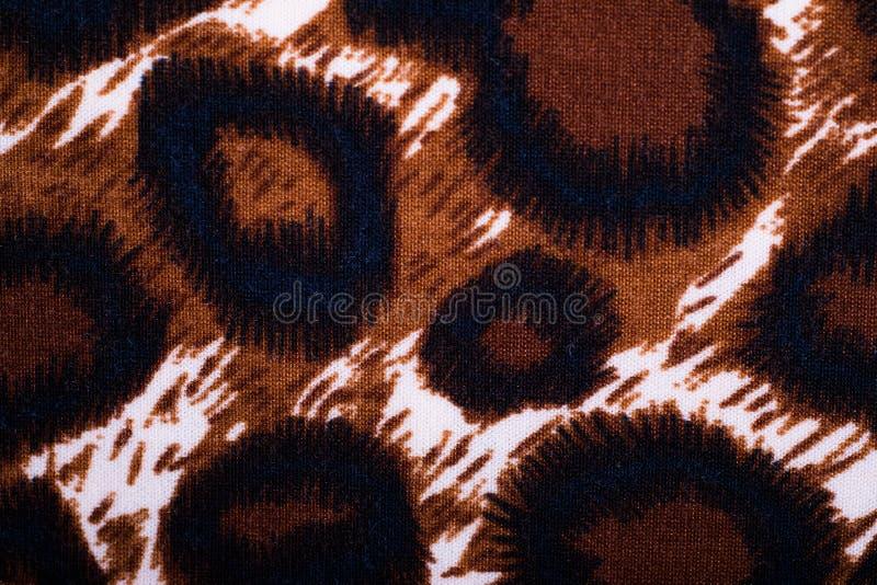 Primo piano del materiale indigeno di stile con progettazione della stampa del leopardo fotografia stock libera da diritti