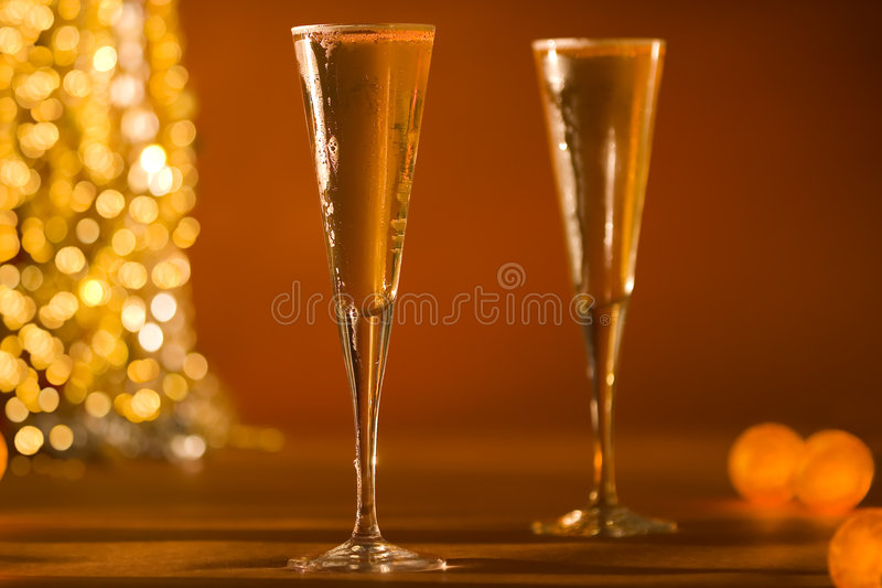 Primo piano del vetro scanalato in di Champagne & di Gol d'ardore fotografia stock