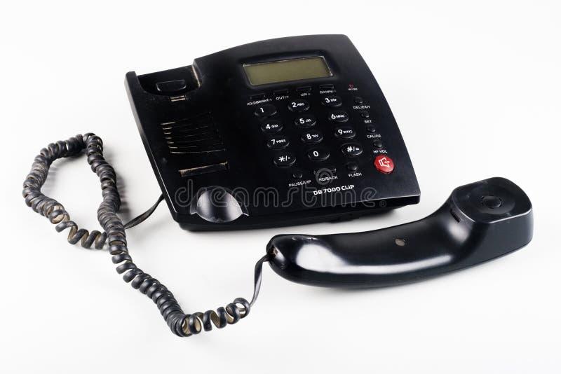 Primo piano dell'fuori il telefono della linea terrestre del nero dell'amo immagine stock libera da diritti