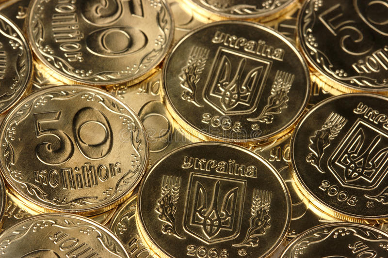 Primo piano dell'monete dorate immagini stock libere da diritti