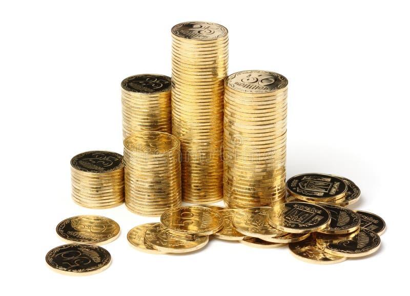 Primo piano dell'monete dorate immagini stock