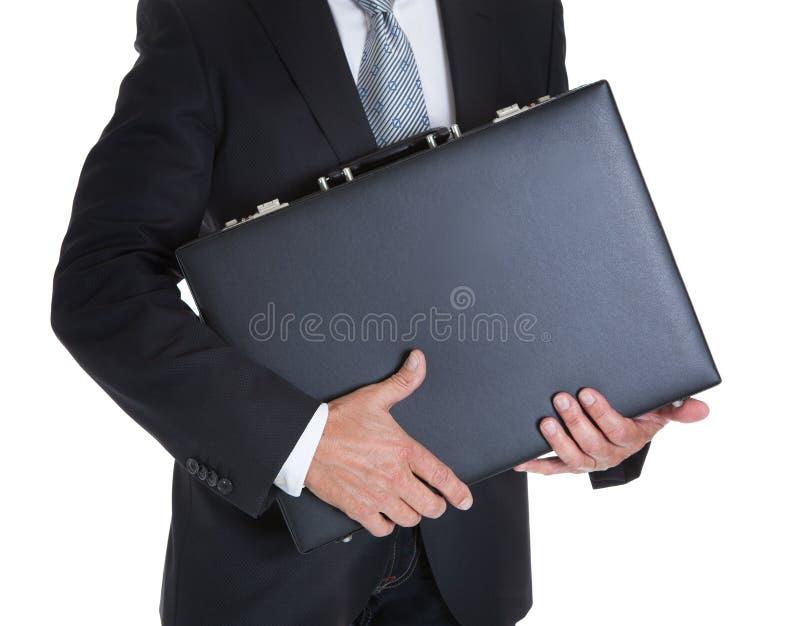 Primo piano dell'uomo d'affari Holding Briefcase fotografia stock