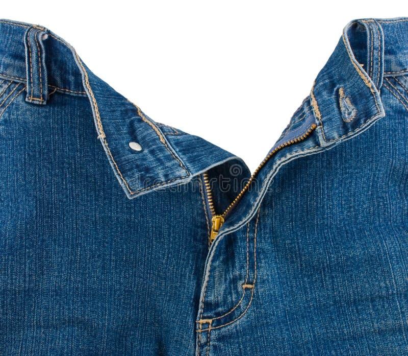 Primo piano della chiusura lampo in blue jeans fotografia stock