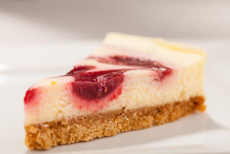 Primo piano della fetta della torta di formaggio immagine stock libera da diritti