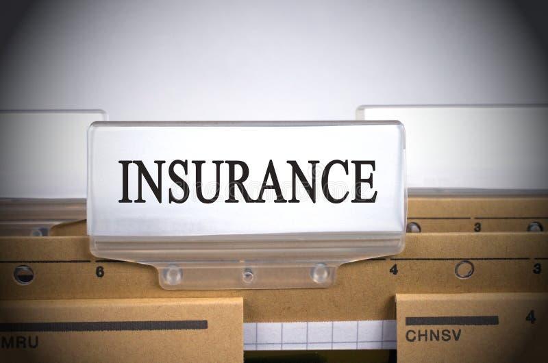 Primo piano della linguetta di indice della cartella di assicurazione immagini stock libere da diritti