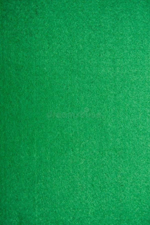 Primo piano della priorità bassa verde del feltro della tabella della mazza fotografie stock