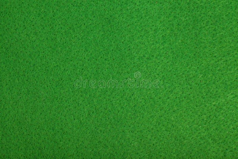 Primo piano della priorità bassa verde del feltro della tabella della mazza fotografia stock