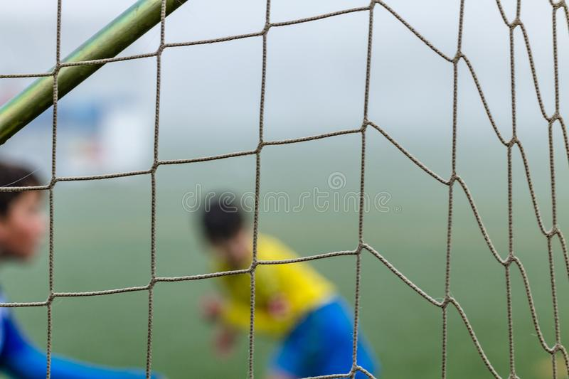 Primo piano della rete di calcio Fuoco selettivo fotografia stock libera da diritti