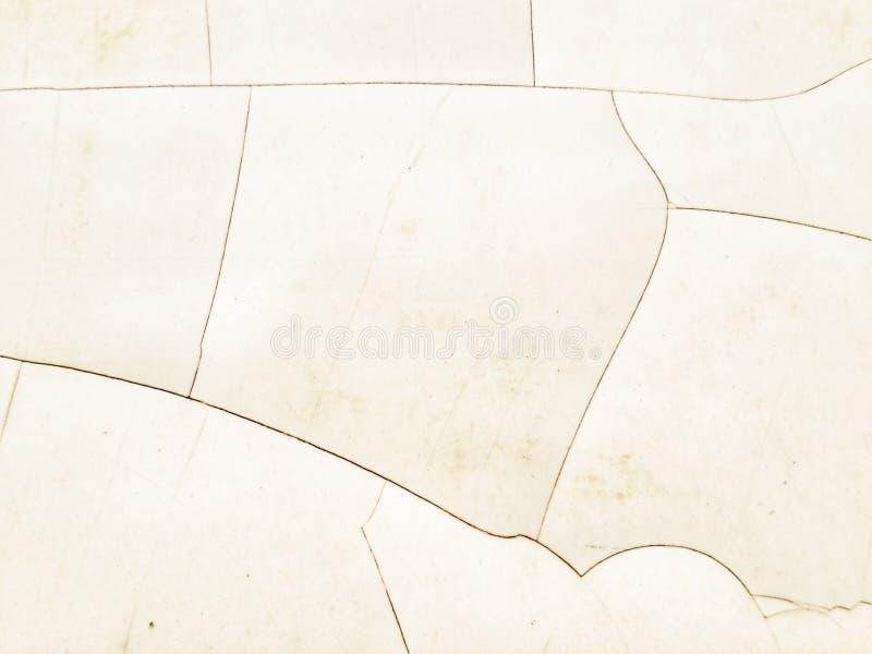 Primo piano delle crepe della piastrella per pavimento sparato da sopra fotografia stock libera da diritti
