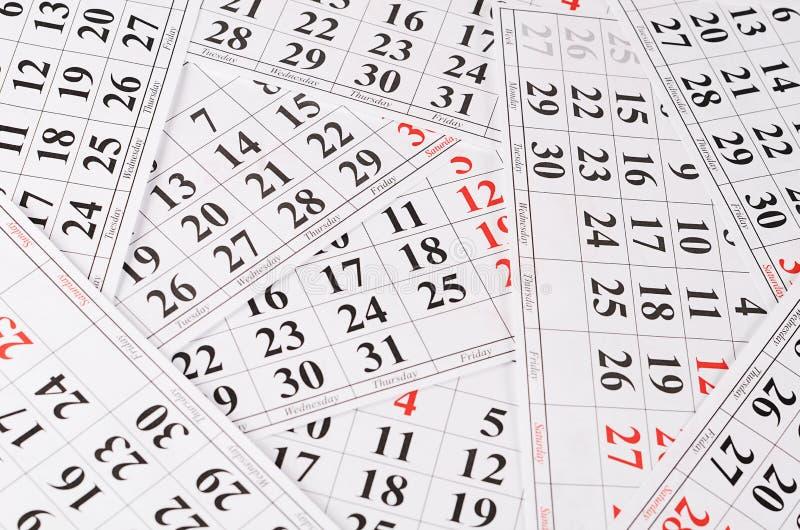 Primo piano delle date alla pagina del calendario fotografia stock libera da diritti