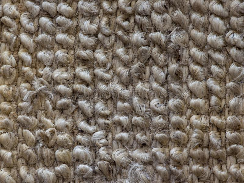 Primo piano delle fibre del tappeto Priorità bassa astratta beige fotografia stock