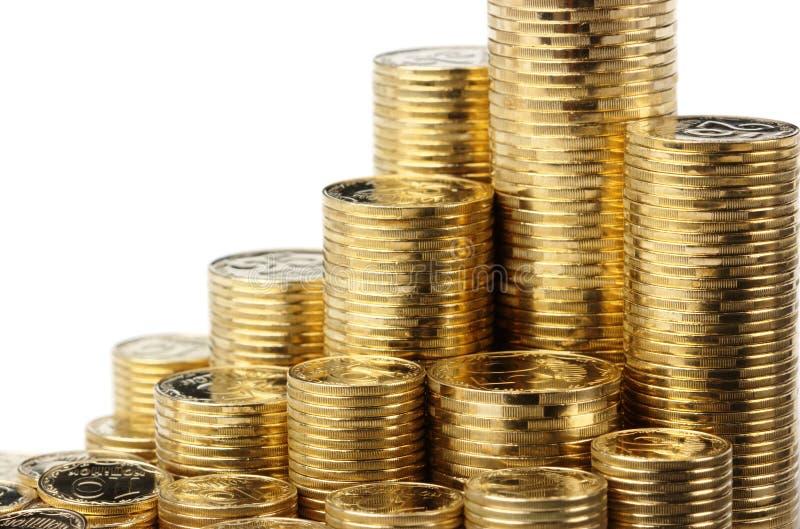 Primo piano delle monete dorate fotografia stock