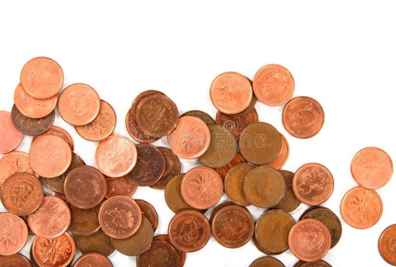 Primo piano delle monete su priorità bassa bianca immagine stock