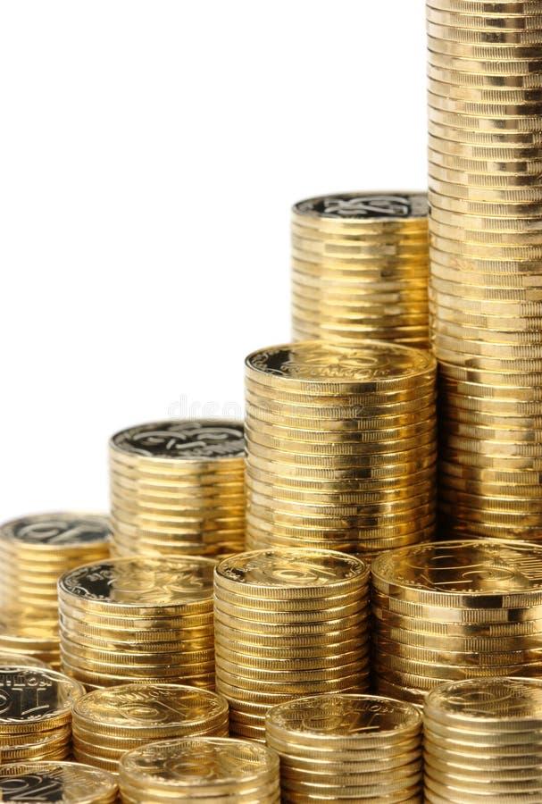 Primo piano delle pile dorate delle monete fotografia stock