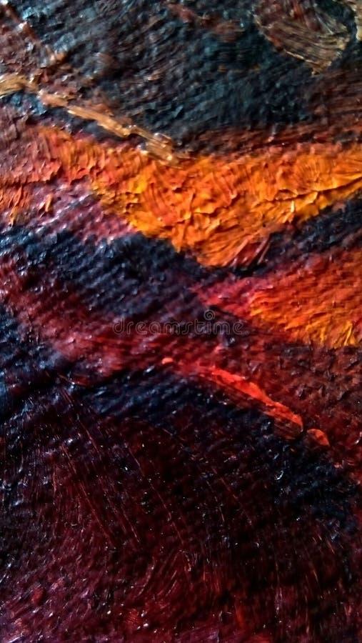 Primo piano delle sbavature della pittura ad olio sulla superficie della tela fotografia stock libera da diritti