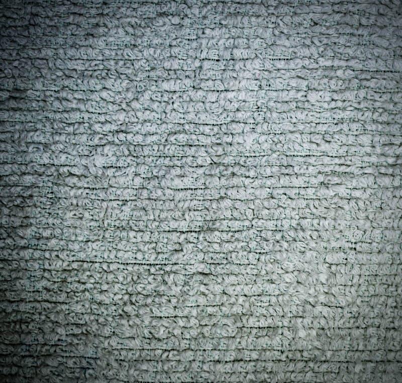 Primo piano dettagliato di struttura del tessuto spugna del tessuto con la scenetta fondo, natura morta royalty illustrazione gratis