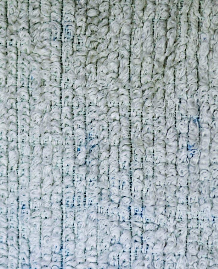 Primo piano dettagliato di struttura del tessuto spugna del tessuto fondo, natura morta illustrazione di stock