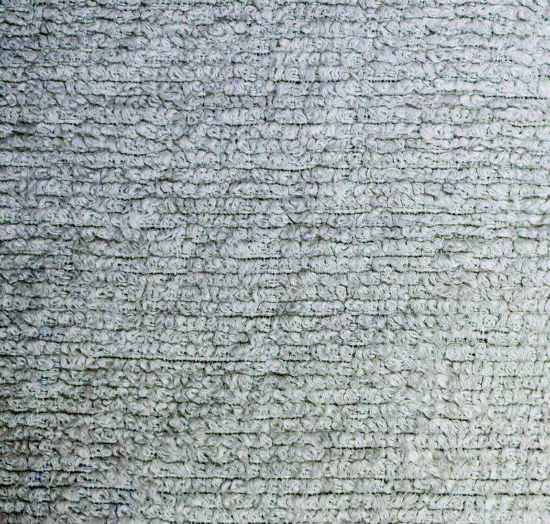 Primo piano dettagliato di struttura del tessuto spugna del tessuto fondo, natura morta royalty illustrazione gratis