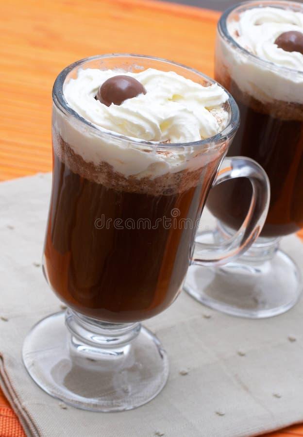Primo piano di caffè con crema fotografie stock