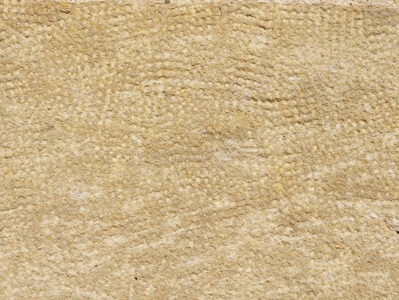 Primo piano di pietra elaborato sulla parete fotografia stock libera da diritti